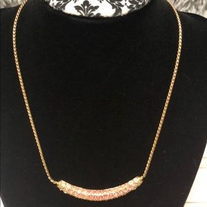 Gold necklace with white and gold rhinestones